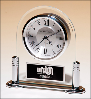 Desk clock with beveled glass upright and silver metal base, three hand clock movement